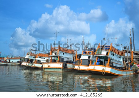 Fishing boat at harbor in bay  - stock photo