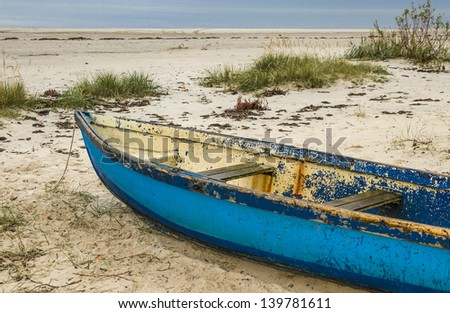 Fishing boat at sandy beach near of fishermen village, Baltic Sea, Latvia, Europe - stock photo