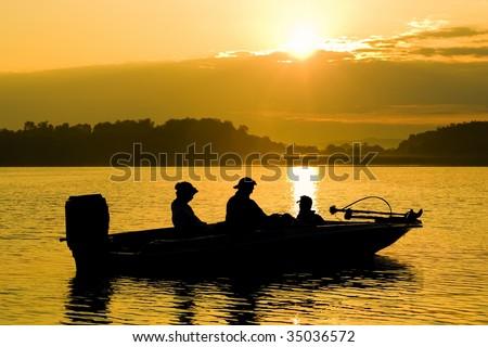 Fishing Boat at Sunrise - stock photo