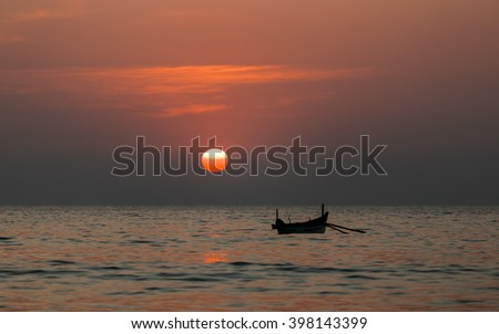 Fishing boat at sunset. Goa, India,Arabian Sea. - stock photo