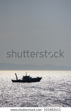 Fishing boat at sunset in Greece