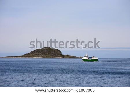 Fishing boat at the coast - stock photo