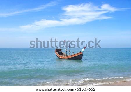 Fishing boat at the shore of the Saint Martins Island of Bangladesh - stock photo