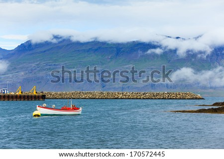 Fishing boat. Beautiful view of East fjords Iceland - stock photo