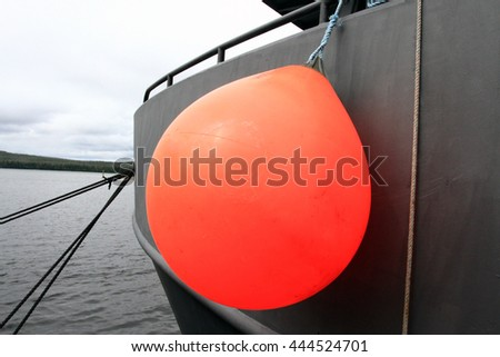 Fishing boat bumper or fender - stock photo