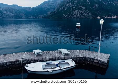 fishing boat docked at dawn - stock photo