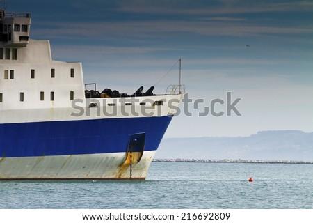 Fishing boat docked at the port - stock photo