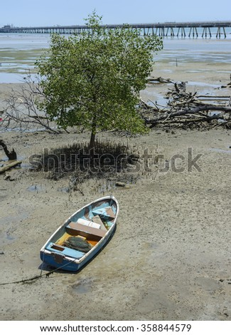 Fishing boat during a tide. - stock photo