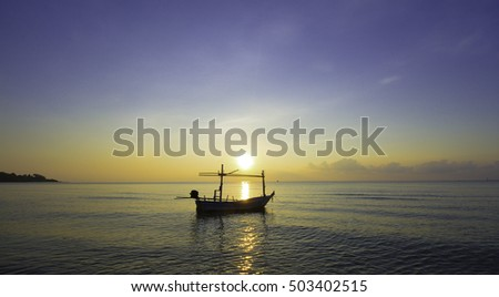 Fishing boat floating on the water, blue sea and sky with copyspace