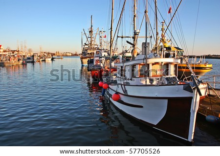 Fishing boat in a harbor - stock photo