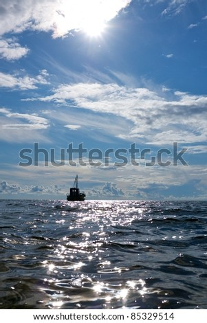 Fishing boat in a sea. - stock photo