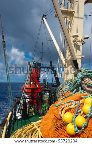 Fishing boat in blue atlantic ocean - stock photo