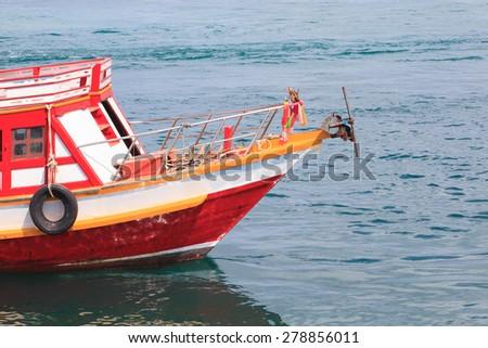 Fishing Boat in Blue Sea - stock photo