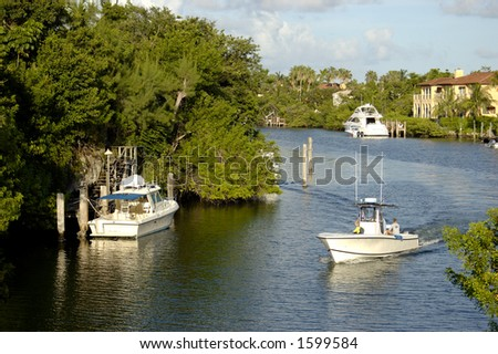 Fishing Boat in Canal in Florida - stock photo