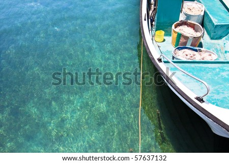 Fishing boat in crystal clear turquoise water