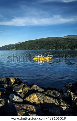 Fishing boat in fjords of Norway
