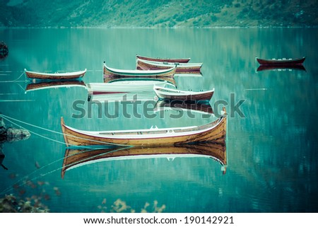Fishing boat in harbour Reine, Lofoten Islands, Norway - stock photo