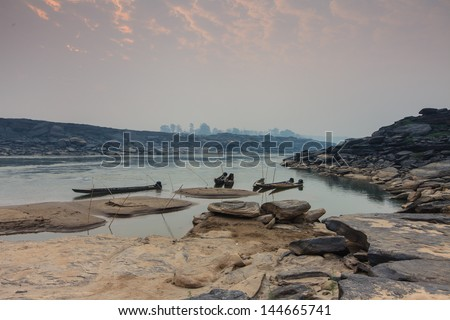 fishing boat in Mekong river, Ubonrachatani province - stock photo