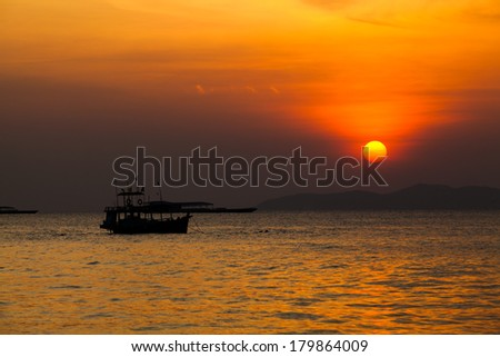 Fishing boat   in Thailand. Silhouette of Fishing Boat on Sunrise.