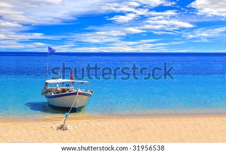 Fishing boat in the Ionian sea in Greece - stock photo