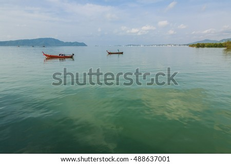 Fishing boat in the sea And the beautiful sky