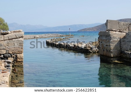 Fishing boat in the sea in Greece underwater city of olous - stock photo