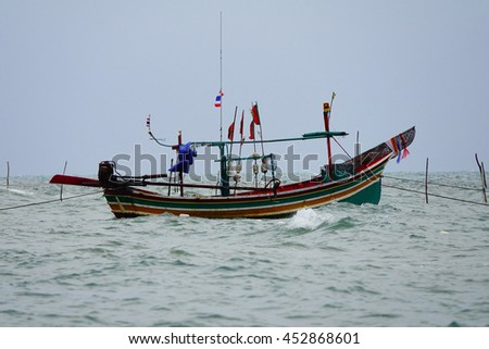 fishing boat in the sea,select focus with shallow depth of field.