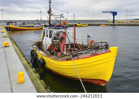 Fishing boat  in the small port - stock photo