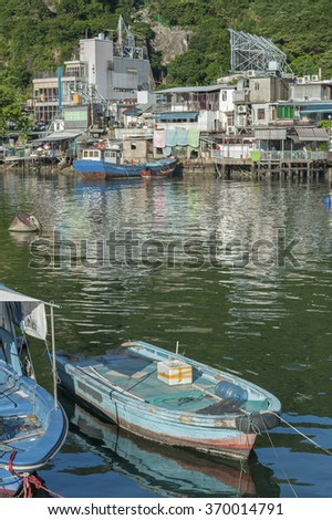Fishing boat in typhoon shelter in Hong Kong - stock photo