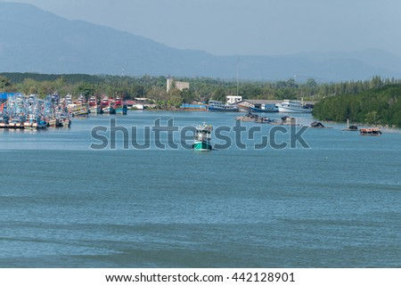 Fishing boat is out fishing. Fishermen is a career that has been popular in the seaside city of Thailand. - stock photo