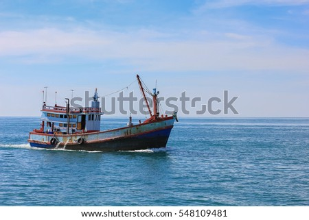 Fishing boat is out fishing. Fishermen is a career that has been popular in the seaside city of Thailand.