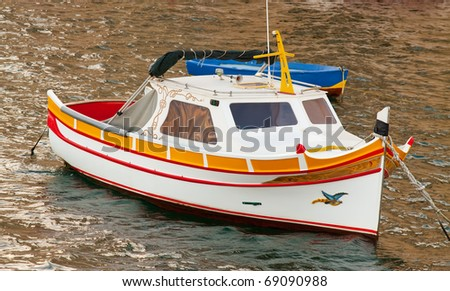 Fishing boat lying at Grand harbour. Malta - stock photo