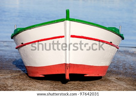 Fishing boat on a ramp near the sea - stock photo