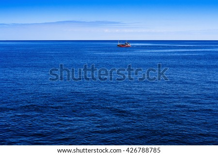 Fishing boat on open water sites