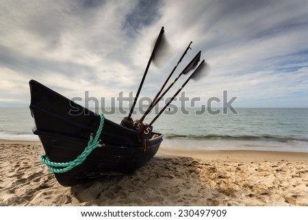 Fishing boat on sandy beach in north Poland.Baltic Sea/Fishing boat Baltic Sea - stock photo