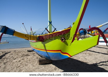 Fishing boat on Sanur Beach, Bali - stock photo