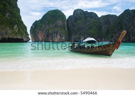 Fishing boat on Thailand beach waiting for tourists