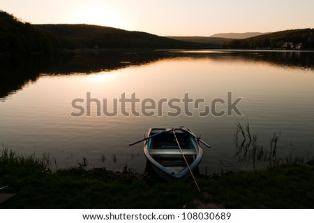 fishing boat on the at the sunset, landscape image