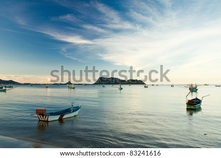 Fishing boat on the beach. - stock photo