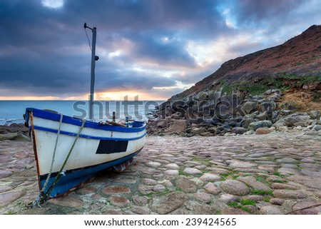 Fishing boat on the beach at Penberth Cove near Penzance in Cornwall - stock photo