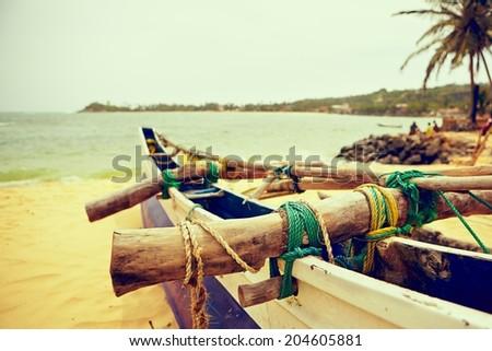 Fishing boat on the beach near Galle in Sri Lanka - stock photo