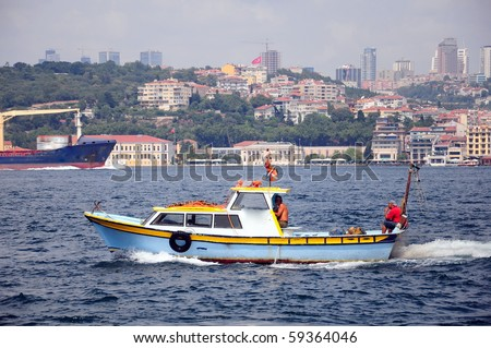 fishing boat on the Bosporus, in Istanbul, Turkey - stock photo
