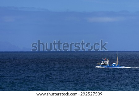 Fishing boat on the ocean - stock photo