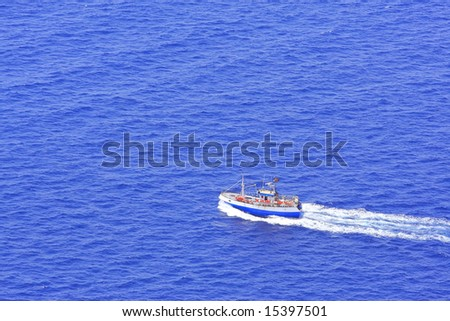 Fishing boat on the sea - stock photo
