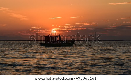 Fishing boat on the sea at sunset.