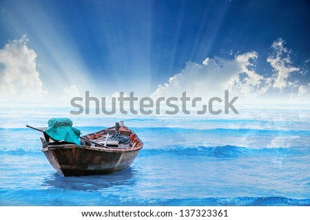 fishing boat on the sea  with sunray, Hua-Hin , Thailand - stock photo