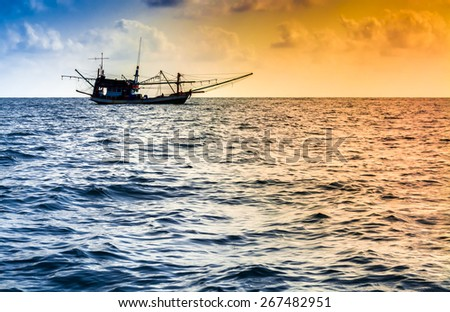Fishing boat on the water and dramatic clouds at.