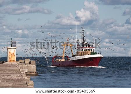 Fishing boat return - stock photo