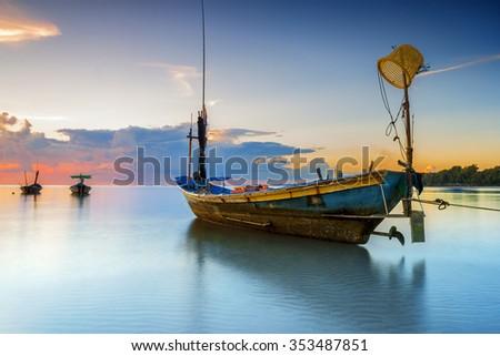 fishing boat Sunset seaside Thailand. - stock photo
