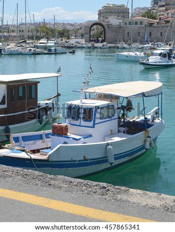 Fishing boat with Heraklion Arsenals behind